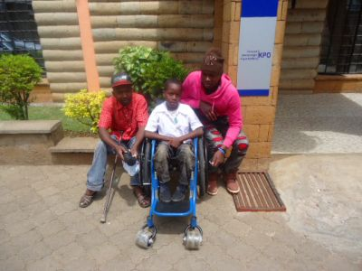 A-young-boy-receives-a-wheelchair